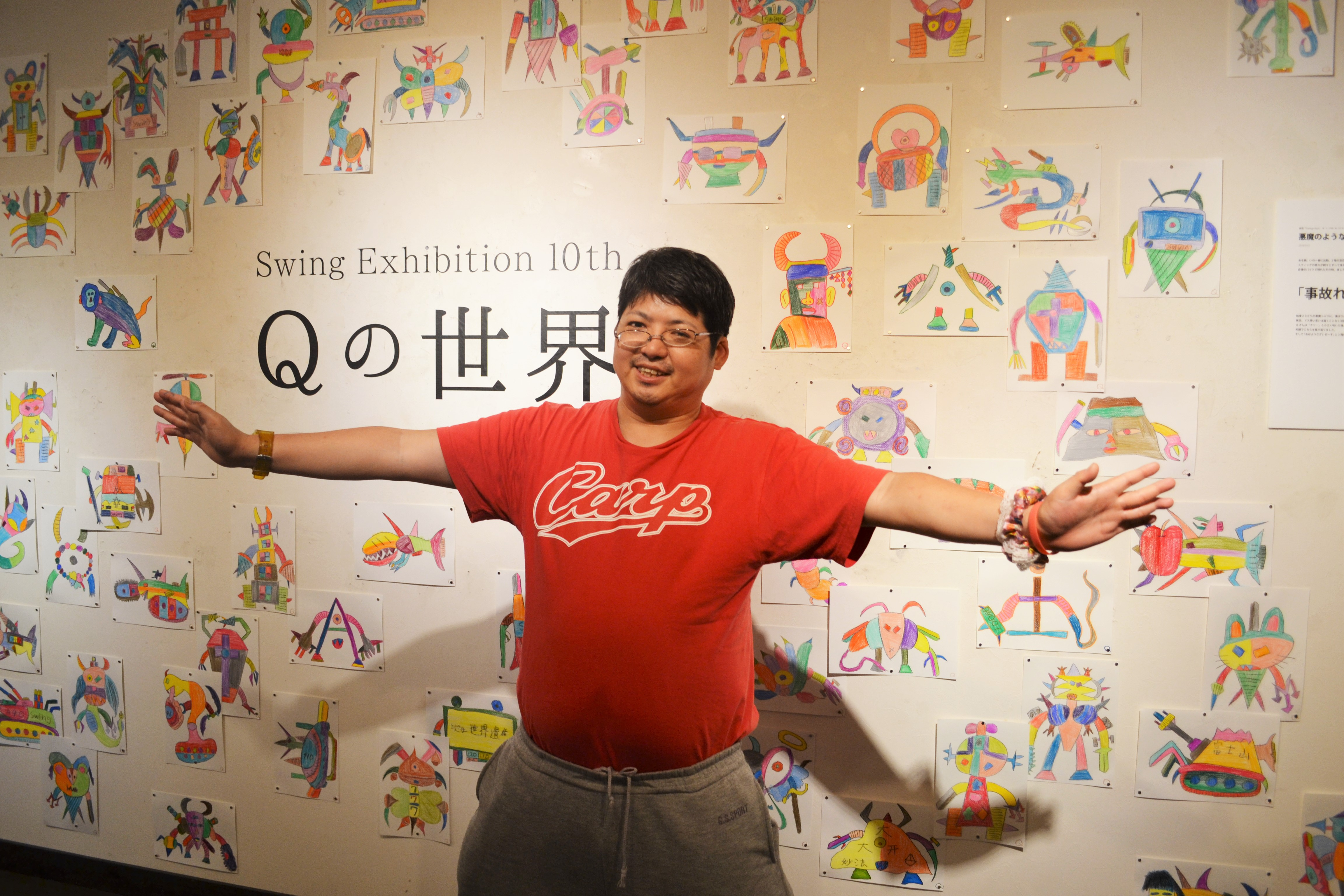 色々なものを合体させた絵を描くQさん。「オレたちひょうげん族」の草創期から活躍する。今年の5月には初の個展「Qの世界」を「恵文社一乗寺店」にて開催。