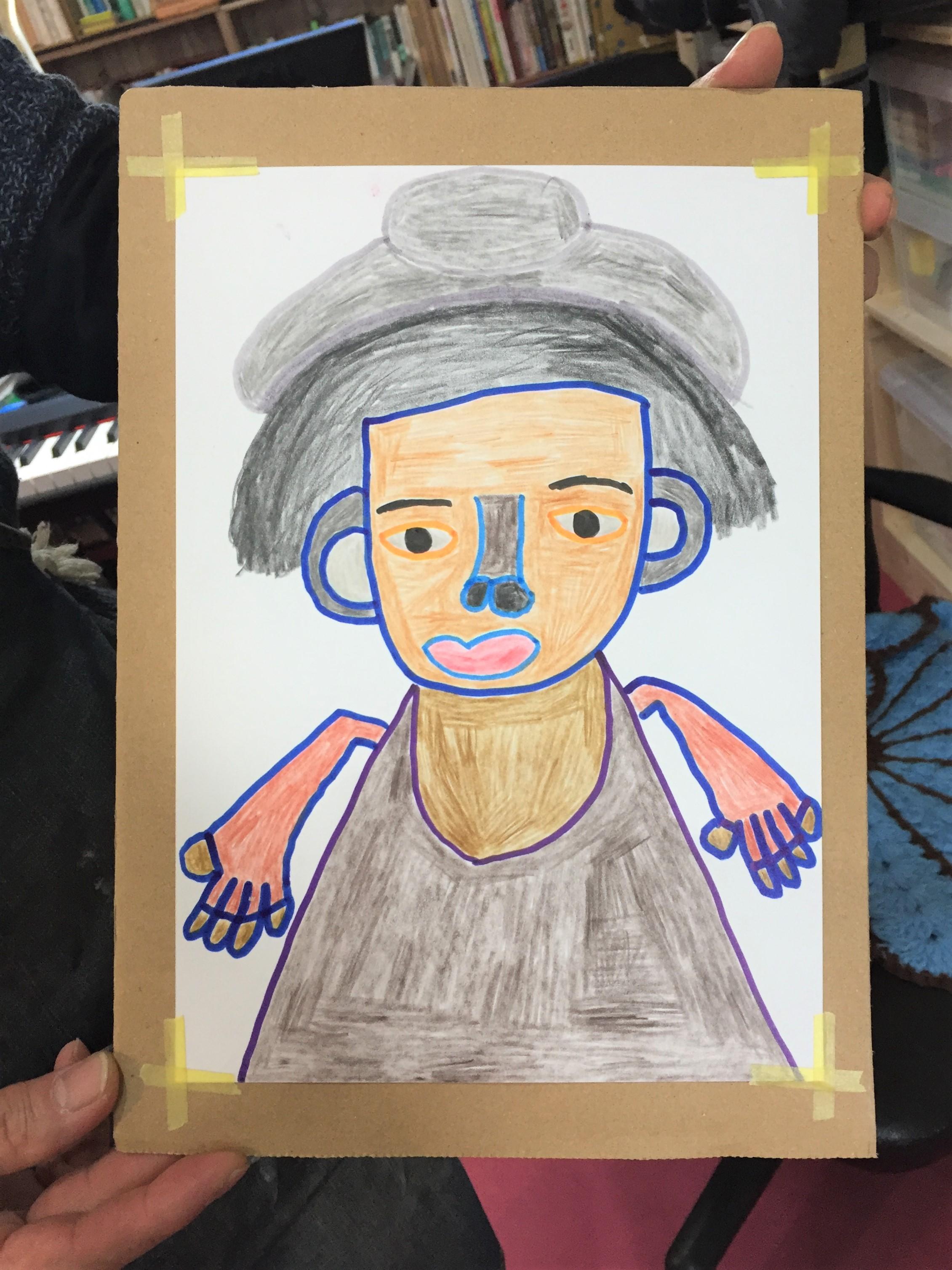 障害をもった人が描いた水野さんの肖像。太い輪郭の中が色鉛筆で丁寧に塗られ何とも言えない味がある。