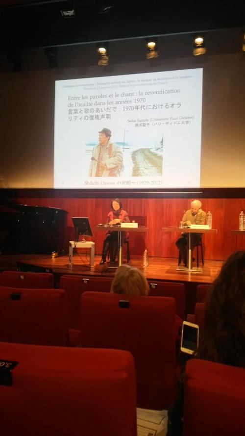 現在は1970年代の音文化について研究をしており、小沢昭一(画像)について調査をしている。写真は2019年1月25日にフランスの国立図書館と協力してオーガナイズした国際シンポジウム「日本の音の記憶」のときのもの